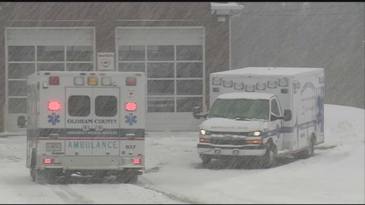 Emergency crews had difficult time clearing roads in Oldham County as additional snow fell.