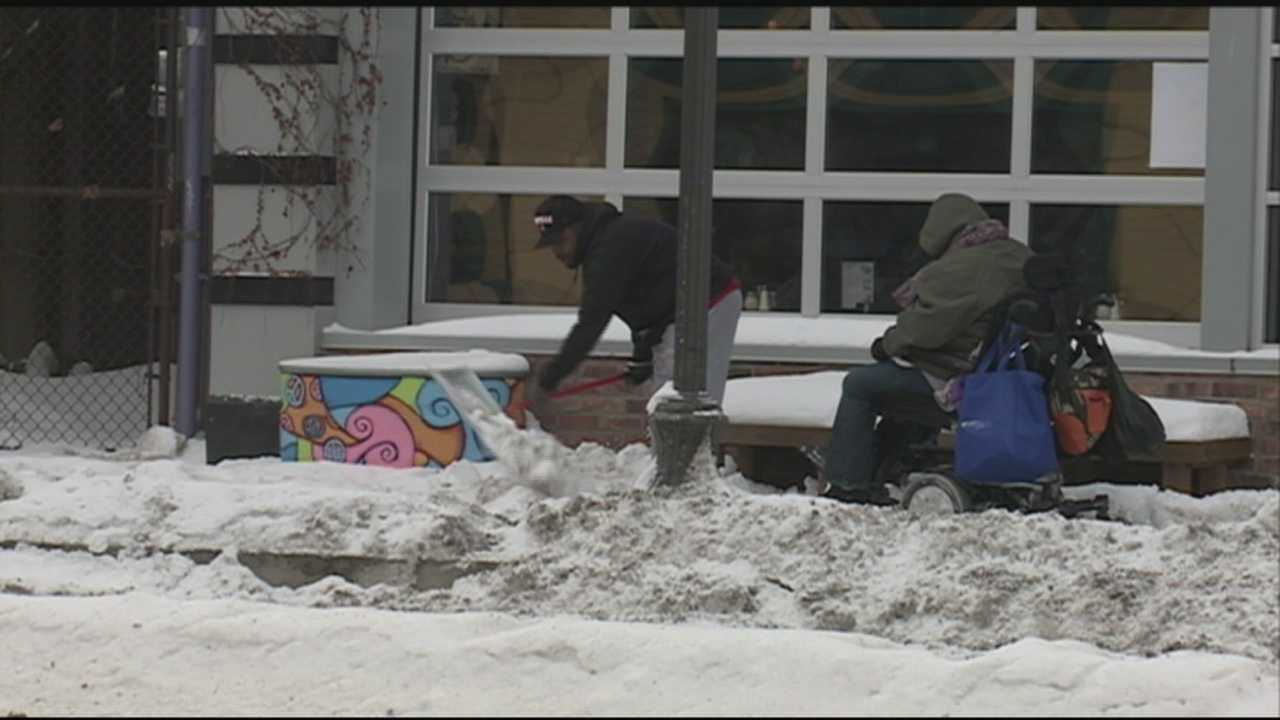 Lisa Jumper was trying to get to a bus stop when her electric wheelchair became stuck in the snow about a block away.