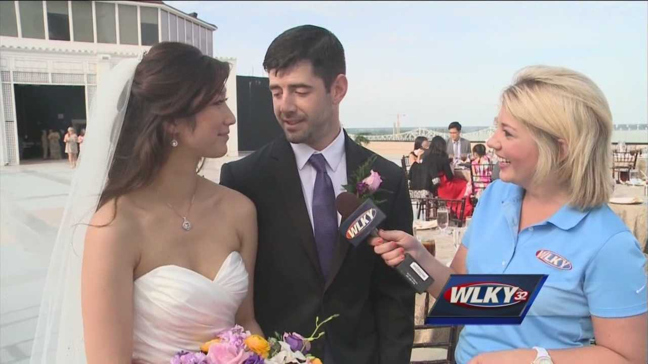 WLKY's Lauren Adams meets Bertina and Josh Paulley, who wed on the 16th floor of the Galt House on Thunder Over Louisville Saturday.
