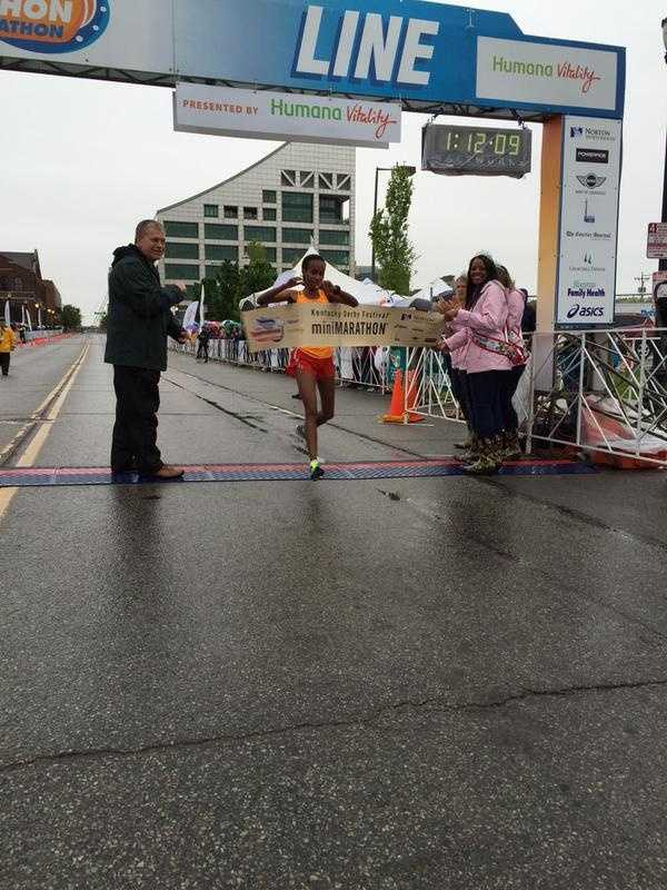 The female mini marathon runner is Ashkale Marachi of Silver Springs, Maryland and she also broke the record, coming in at 1:12:08.