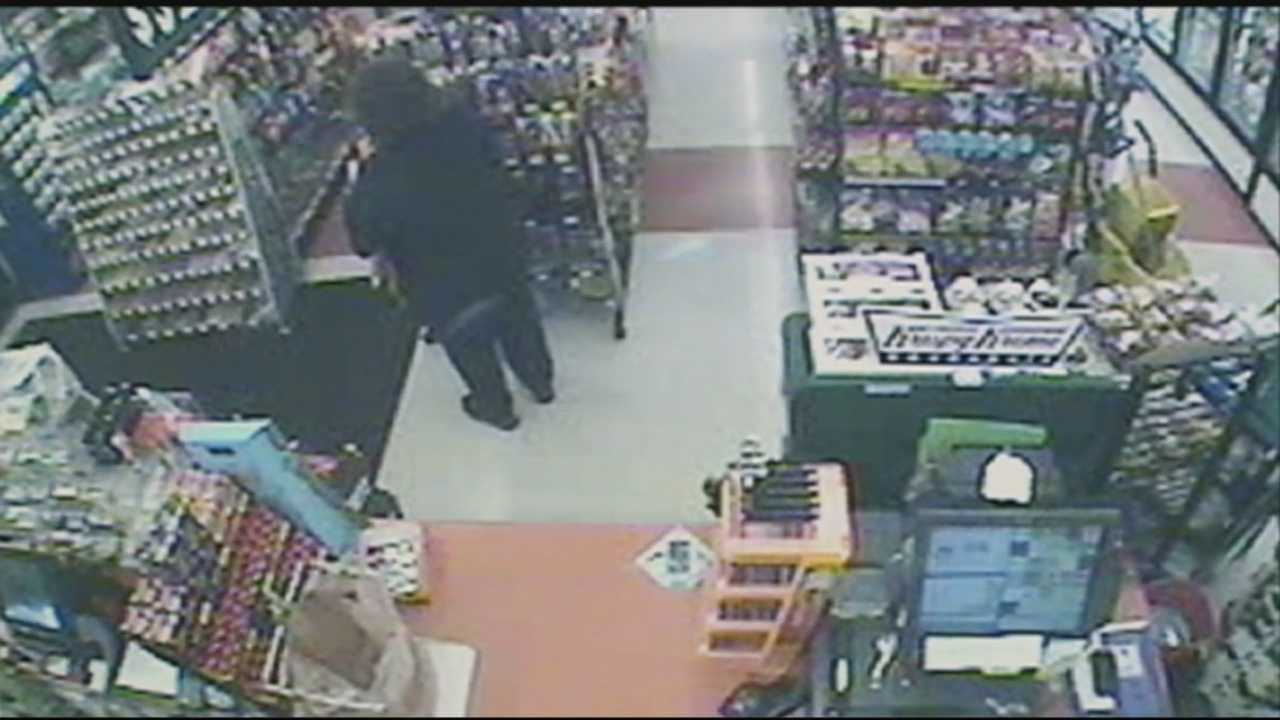Clarksville police search for armed robber, surveillance video shows robbery