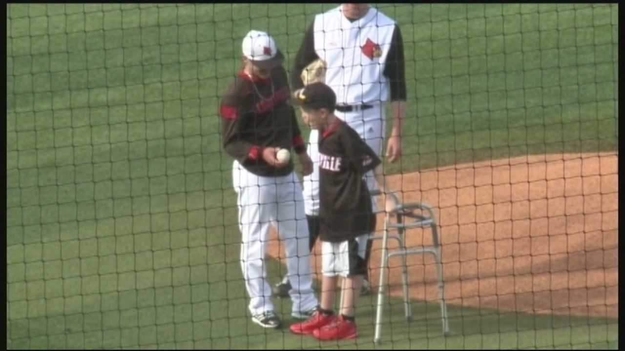 UofL baseball team delivers special first pitch