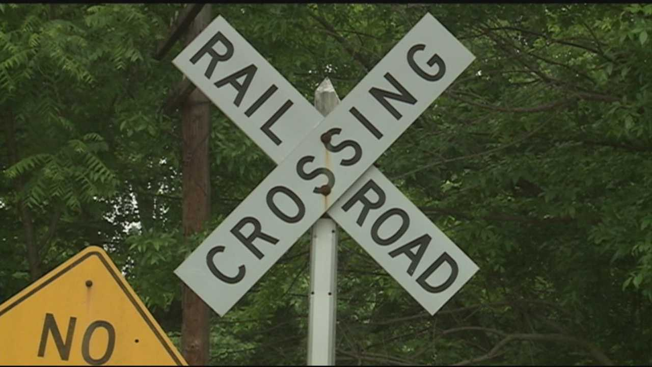Woman killed when car is struck by train identified