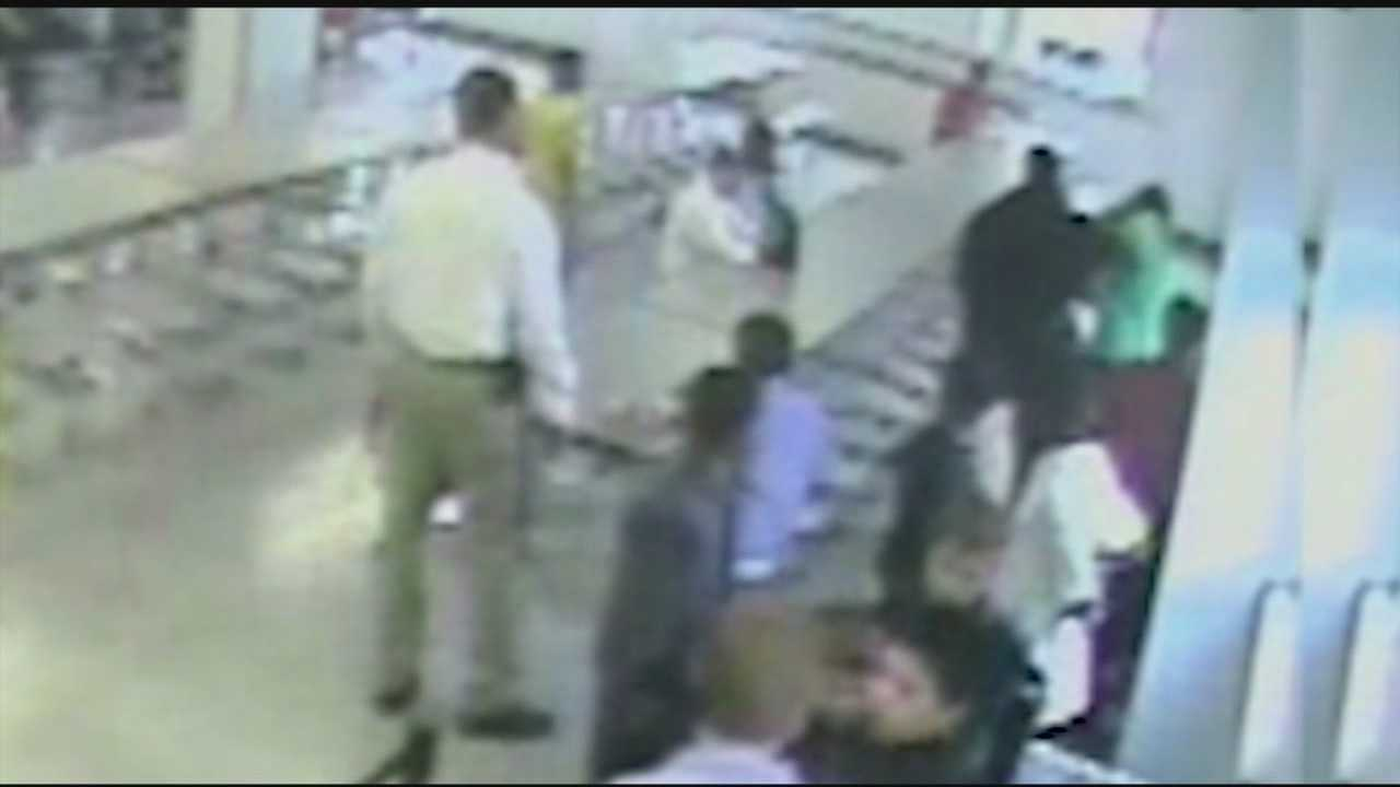 Newly released surveillance video appears to show a former Jefferson County Public Schools resource officer hitting a student.
