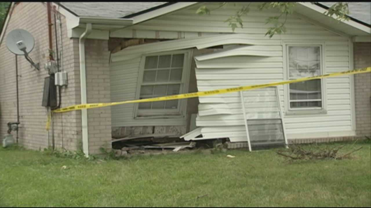 A car barreled through a south Louisville home Wednesday morning while a family was inside.