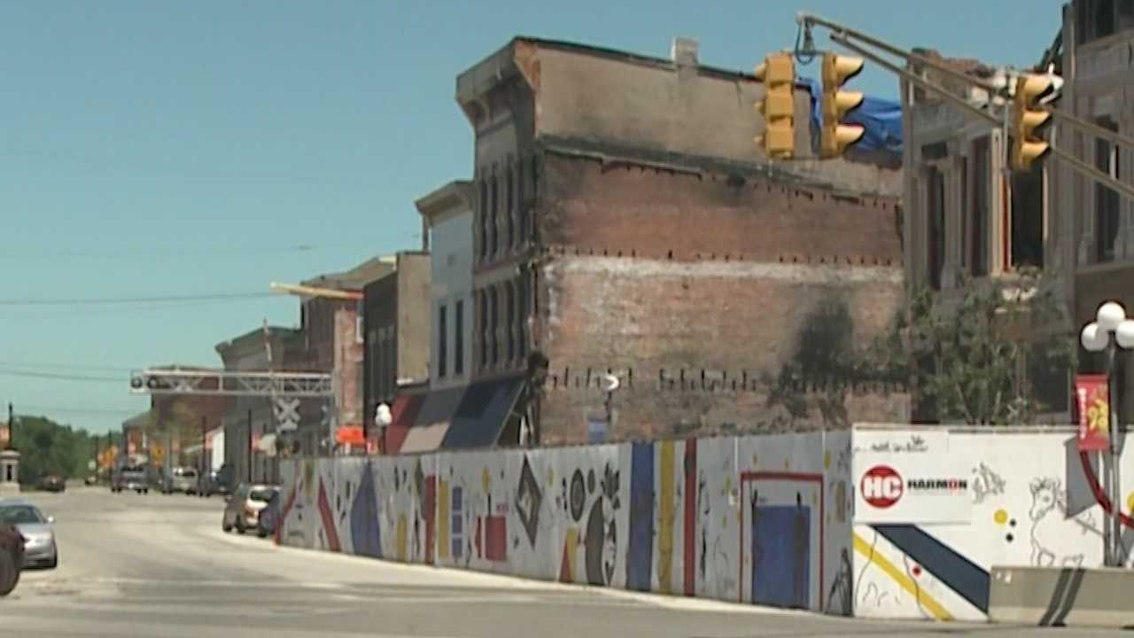 After devastating fire consumed historic buildings, city leaders rebuilding