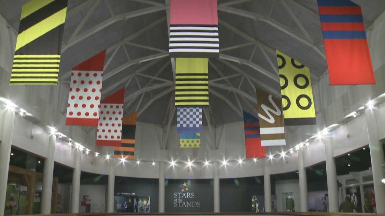Triple Crown winner American Pharoah silks hang in Kentucky Derby Museum