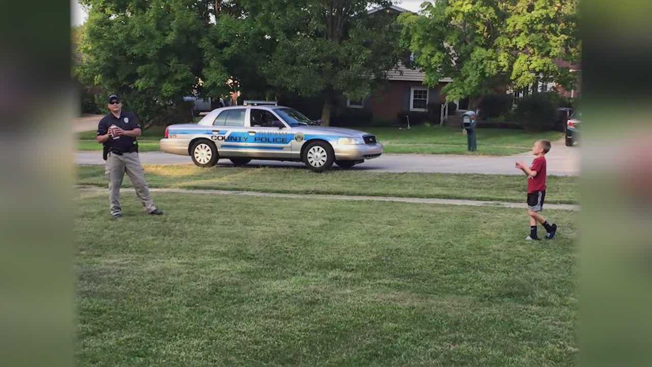Oldham County police officer plays catch with kid while on patrol