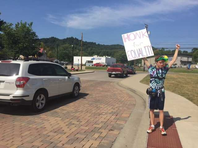 People rally in support of gay marriage after clerk Kim Davis refused to issue marriage licenses to same-sex couples.
