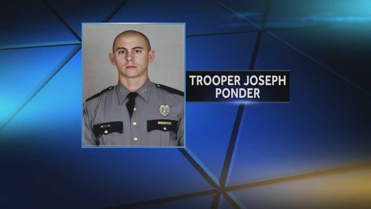 A KSP trooper's father is pushing for bulletproof windows after his son was killed.