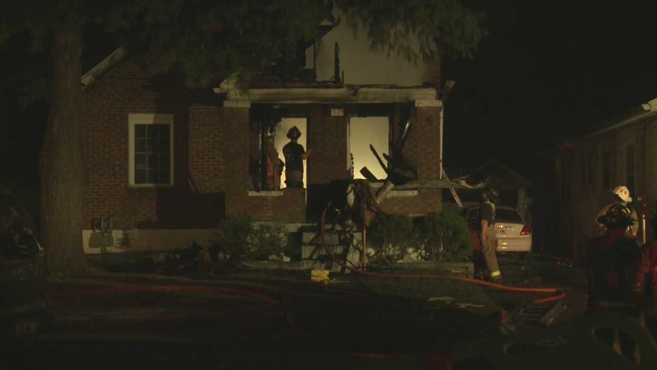 Firefighters are monitoring hot spots at a home in the Wyandotte neighborhood after flames destroyed it Tuesday morning.
