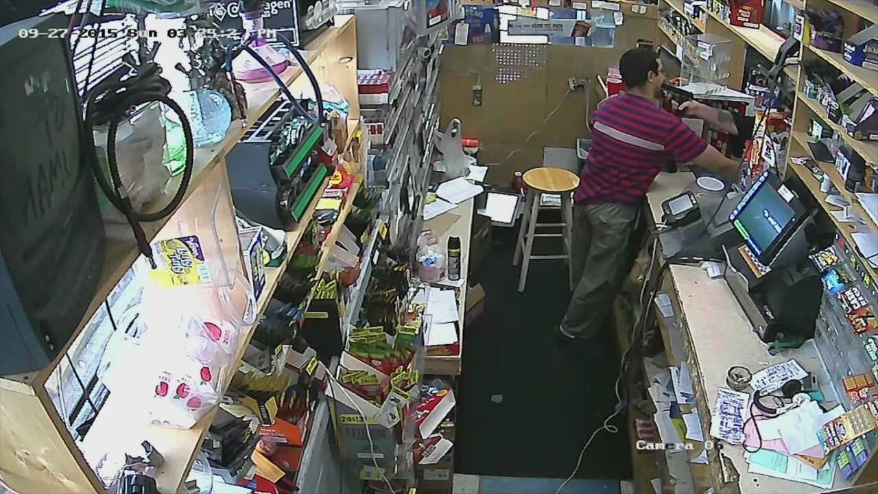 For the first time, the public is seeing surveillance footage that captured a store clerk turning the tables on a robbery suspect.