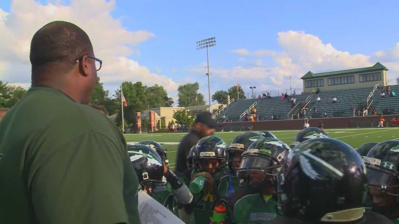 Six Louisville Metro Police Officers, including a former NFL player, are mentoring and coaching a group of young football players.
