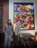 Artist Wilfred E. Sieg III with former Mayor Jerry Abramson with work at Against the Grain Brewery.