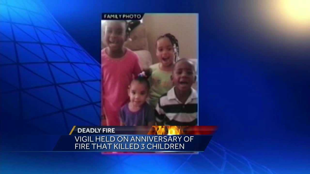 Friends and family held a vigil to remember three children killed in a fire two years ago in New Albany.