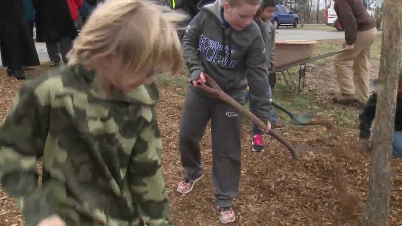 On Friday students helped plant some trees at Medora Elementary School.