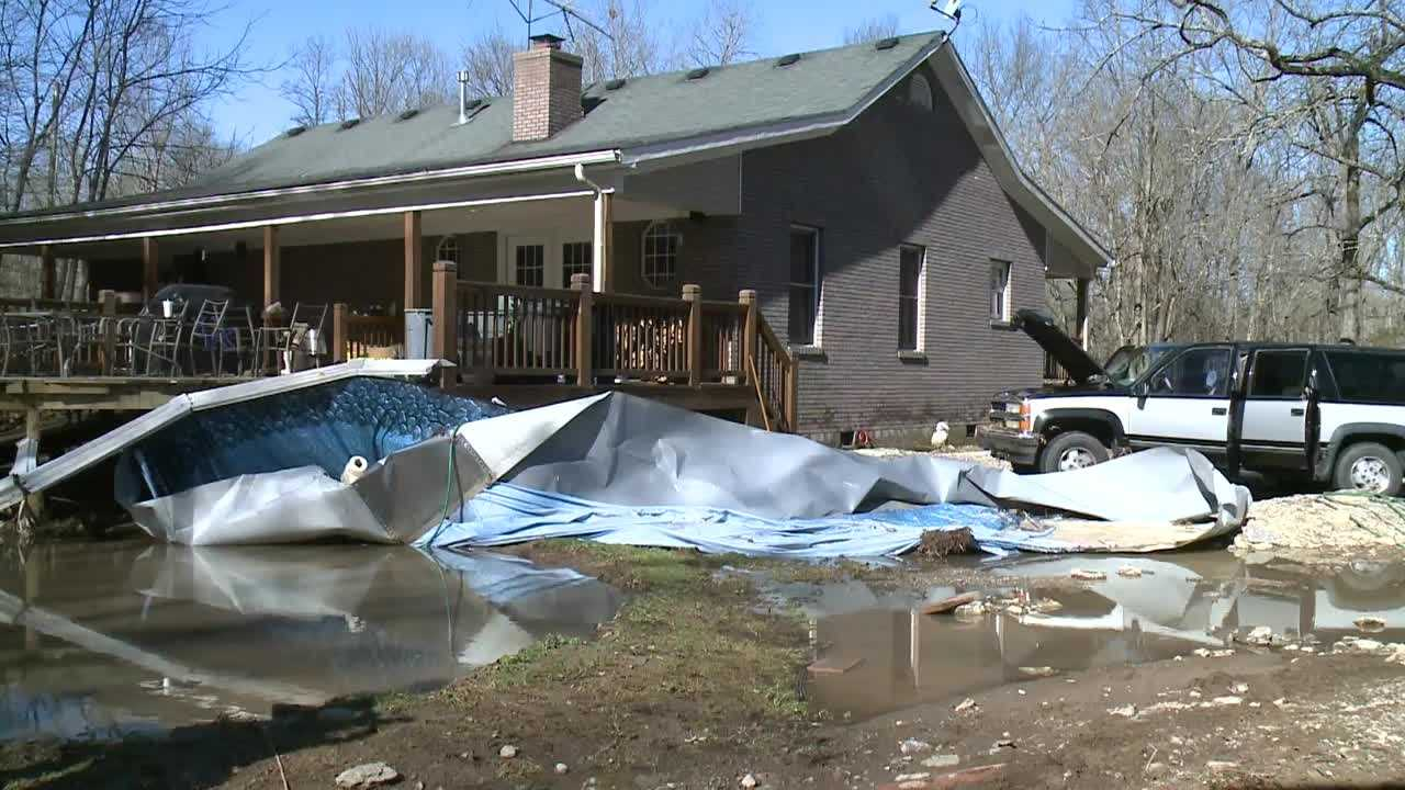 Family rescued after flooding traps them inside home