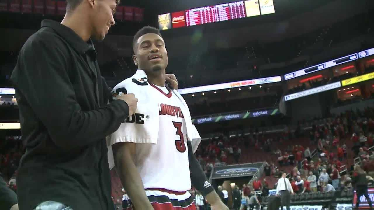 Louisville gets win in first game since self-imposed ban