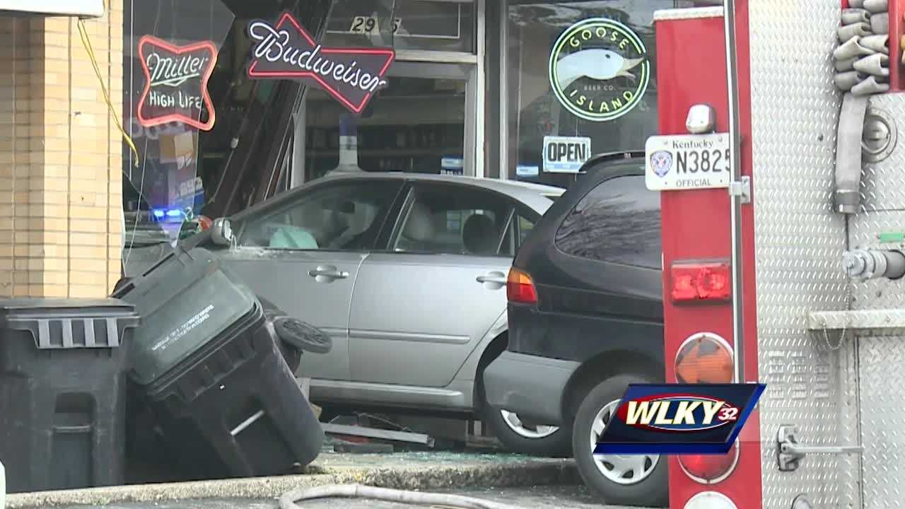 A car crashes through a liquor store Thursday morning in the 2900 block of Brownsboro Road.