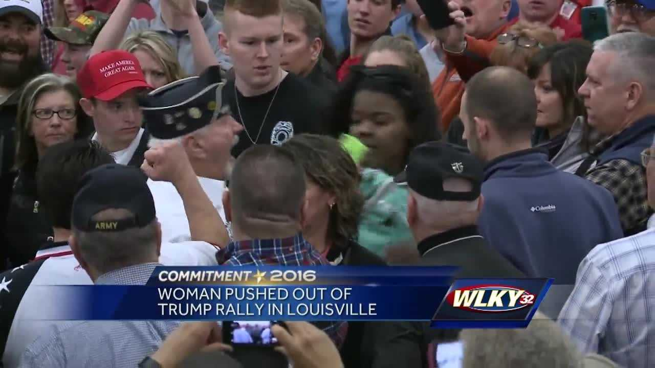 Video showing supporters of Republican presidential front-runner Donald Trump pushing a woman out of Tuesday's rally in Louisville has gone viral.