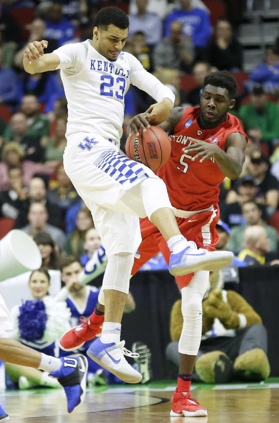 Kentucky guard Jamal Murray, left, steals the ball from Stony Brook guard Ahmad Walker during the first half of a first-round men's college basketball game in the NCAA Tournament, Thursday, March 17, 2016, in Des Moines, Iowa.