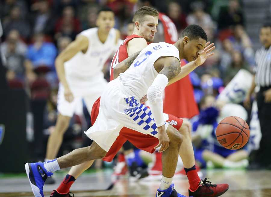 Kentucky guard Tyler Ulis steals the ball from Stony Brook guard Lucas Woodhouse, rear, during the first half of a first-round men's college basketball game in the NCAA Tournament, Thursday, March 17, 2016, in Des Moines, Iowa.
