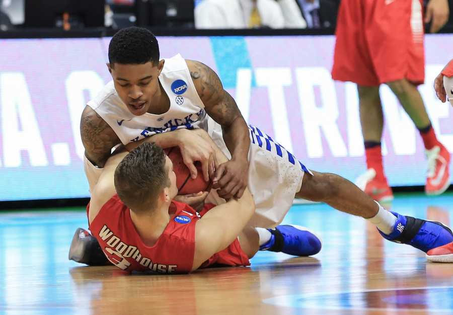 Kentucky's Tyler Ulis, top, and Stony Brook's Lucas Woodhouse (34) struggle for the ball during a first-round men's college basketball game in the NCAA Tournament in Des Moines, Iowa, Thursday, March 17, 2016.