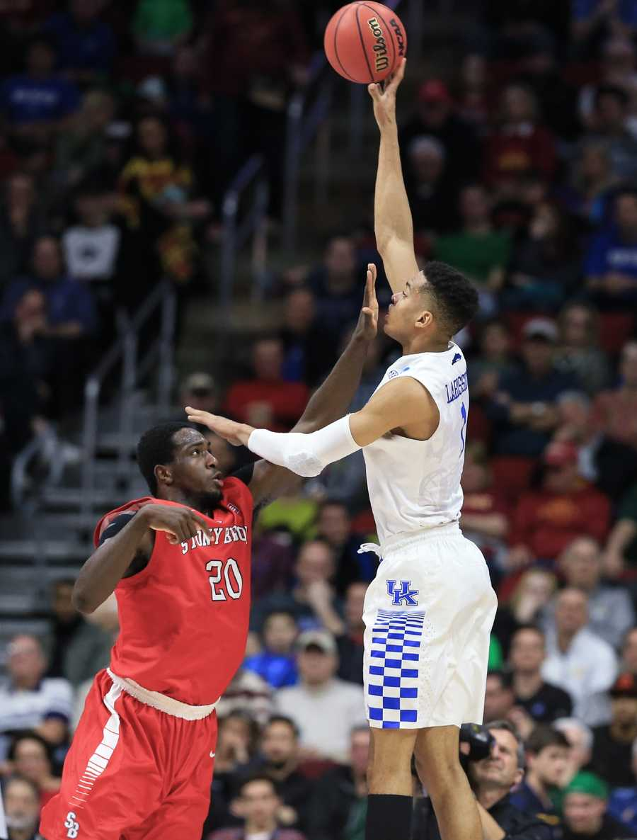 Kentucky's Skal Labissiere (1) shoots over Stony Brook's Jameel Warney (20) during a first-round men's college basketball game in the NCAA Tournament in Des Moines, Iowa, Thursday, March 17, 2016.
