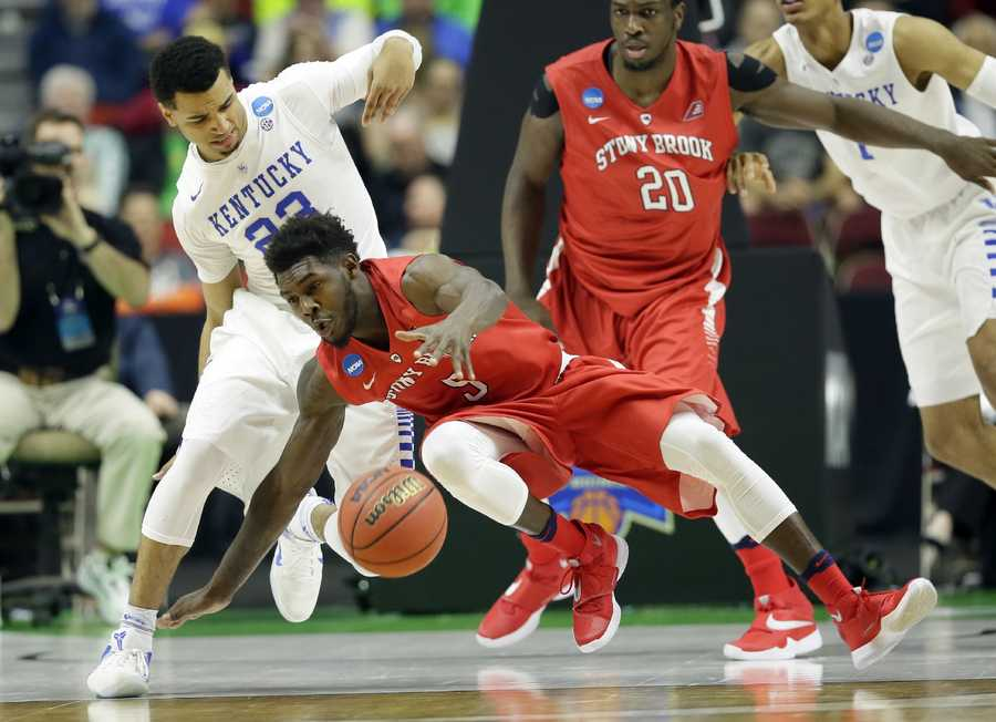 Stony Brook guard Ahmad Walker falls to the court in front of Kentucky guard Jamal Murray, left, during the first half of a first-round men's college basketball game in the NCAA Tournament, Thursday, March 17, 2016, in Des Moines, Iowa.