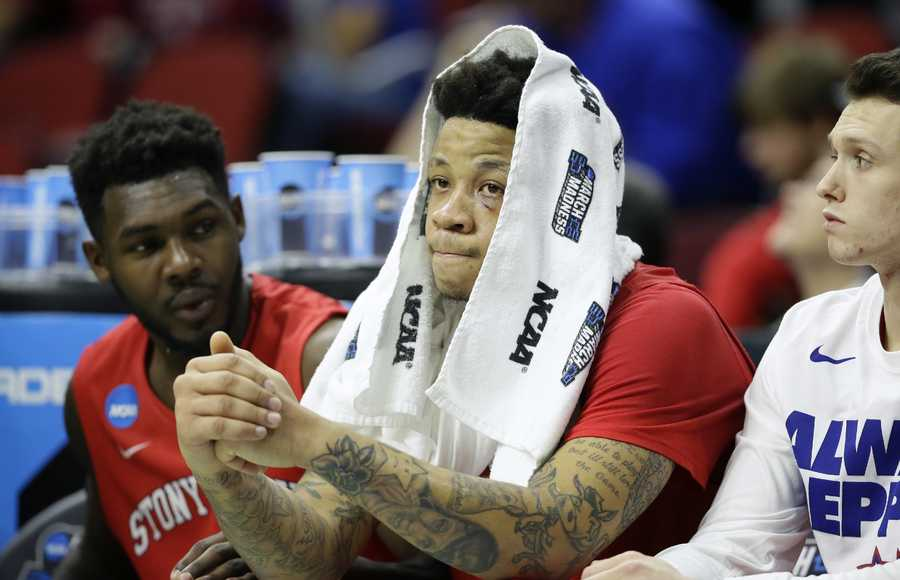 Stony Brook forward Rayshaun McGrew sits on the bench during the second half of a first-round men's college basketball game against Kentucky in the NCAA Tournament, Thursday, March 17, 2016, in Des Moines, Iowa. Kentucky won 85-57.
