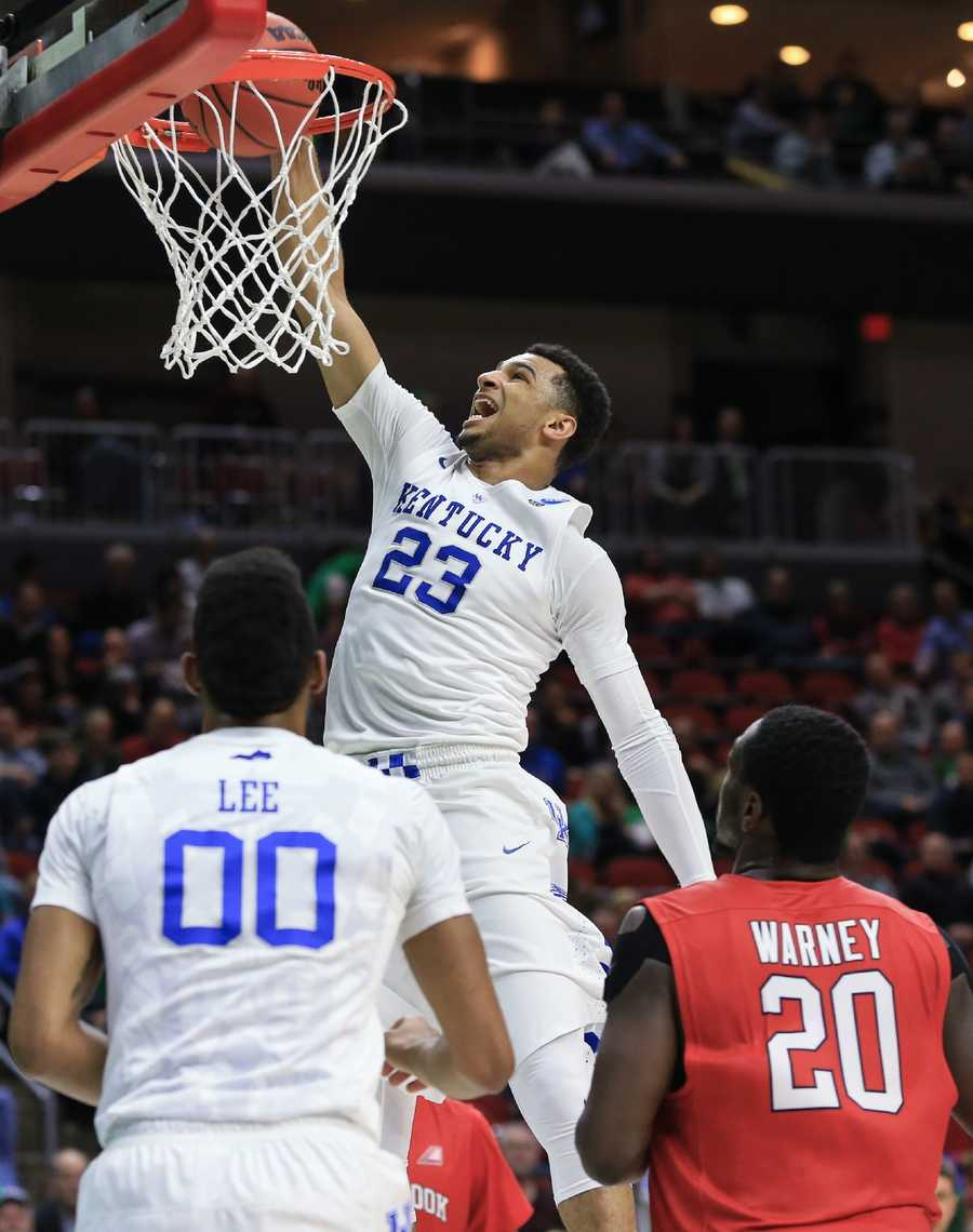 Kentucky's Jamal Murray (23) dunks as Marcus Lee (0) and Stony Brook's Jameel Warney (20) watch, during a first-round men's college basketball game in the NCAA Tournament in Des Moines, Iowa, Thursday, March 17, 2016.