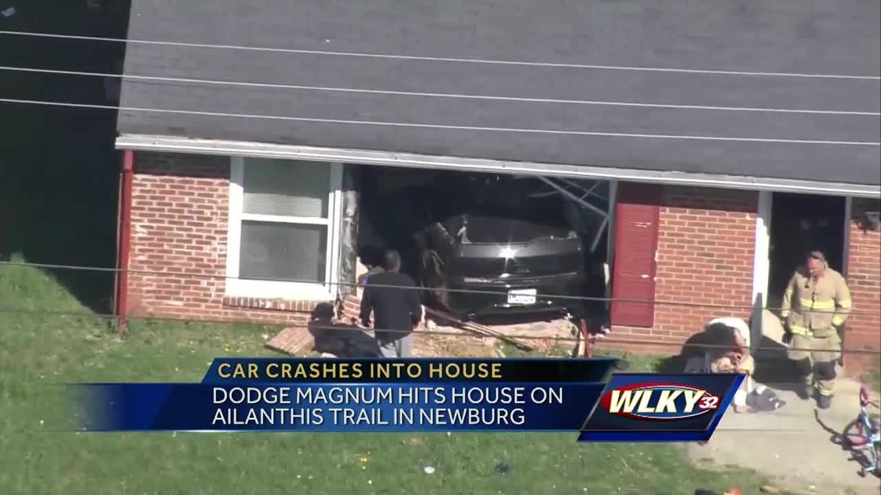 Police continue to investigate after a car hits a house on Ailanthus Trail Monday.