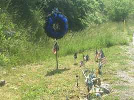 May 25, 2016: A memorial sits along the exit ramp where Jason Ellis was killed.