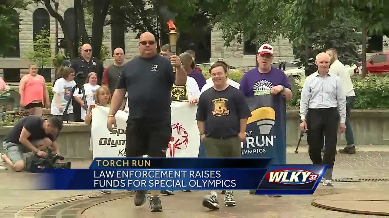 Community members gathered as law enforcement carried the torch for the Special Olympics.