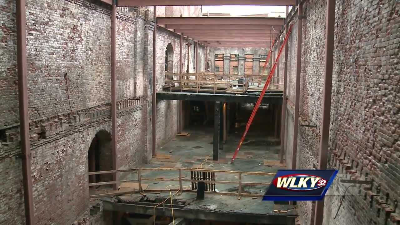 Members of Main Street Revitalization LLC and Mayor Greg Fischer celebrated the significant construction progress of 111 Whiskey Row Wednesday in downtown Louisville.