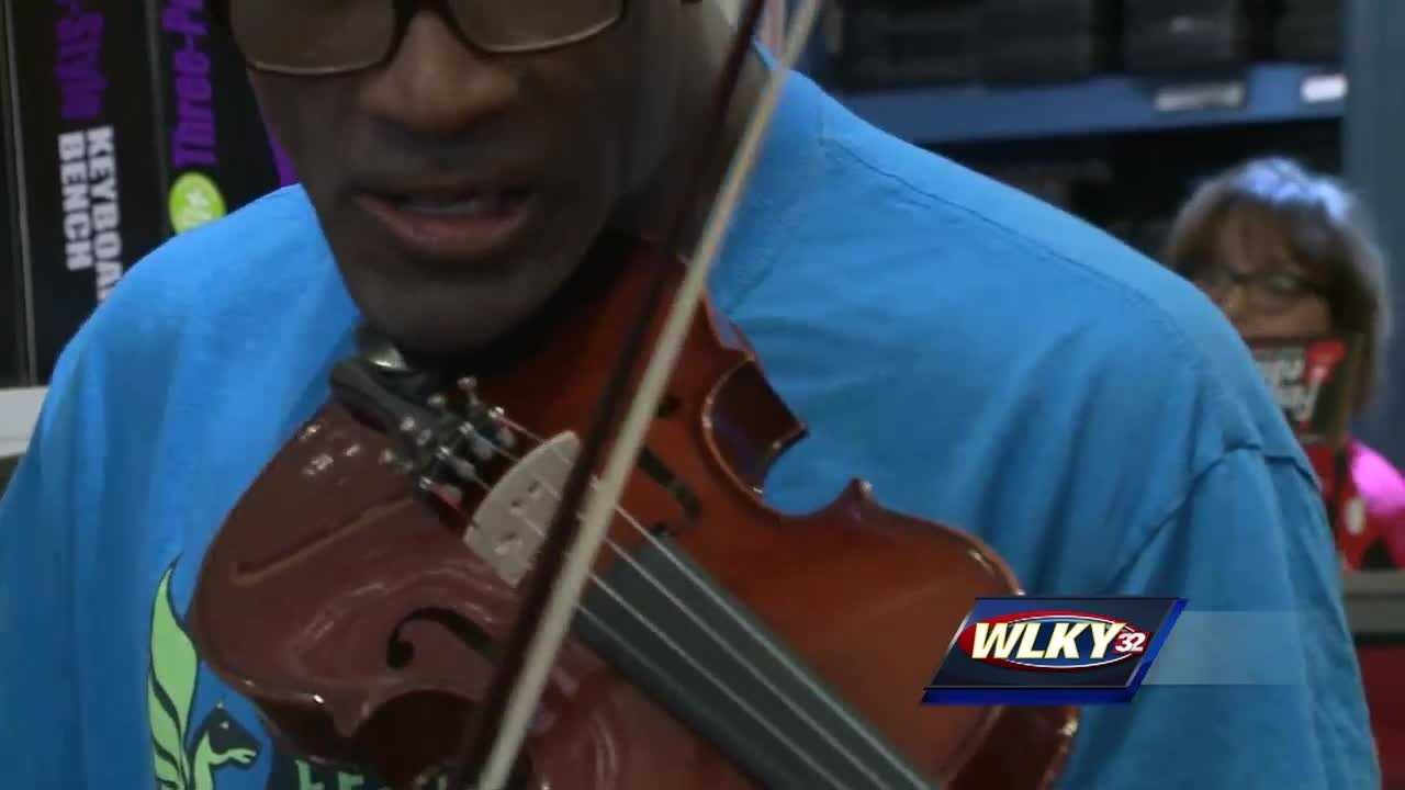 Micah Chandler has been seen playing his violin all around town. But on Friday he said he was eating downtown when his violin disappeared. Thanks to the Doo Wop Shop, he had a new violin within 24 hours