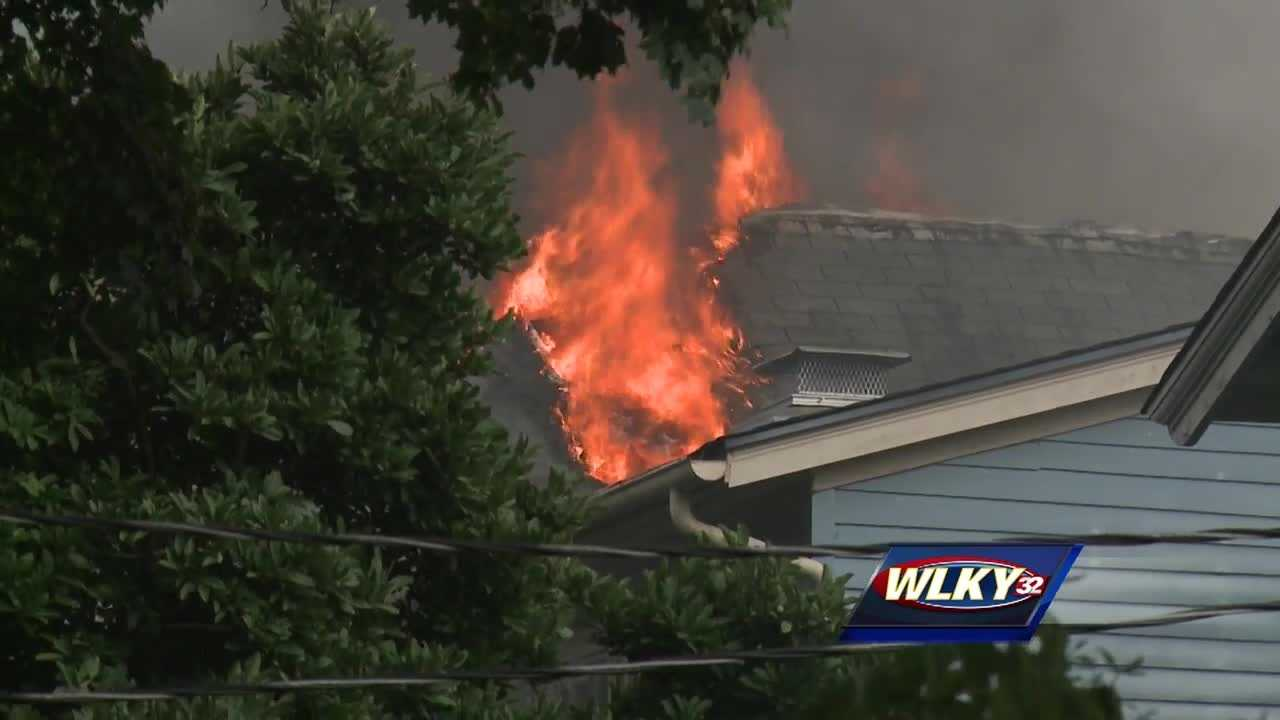 A large fire damaged three homes along a street in the Highlands neighborhood.