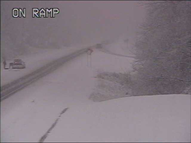I-64 is snow covered and slick west of Evansville near the Indiana State Welcome Center / Rest Area.