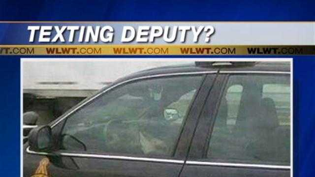 A photo shows a sheriff's deputy appearing to text while driving, which is illegal in Ohio. But is it?