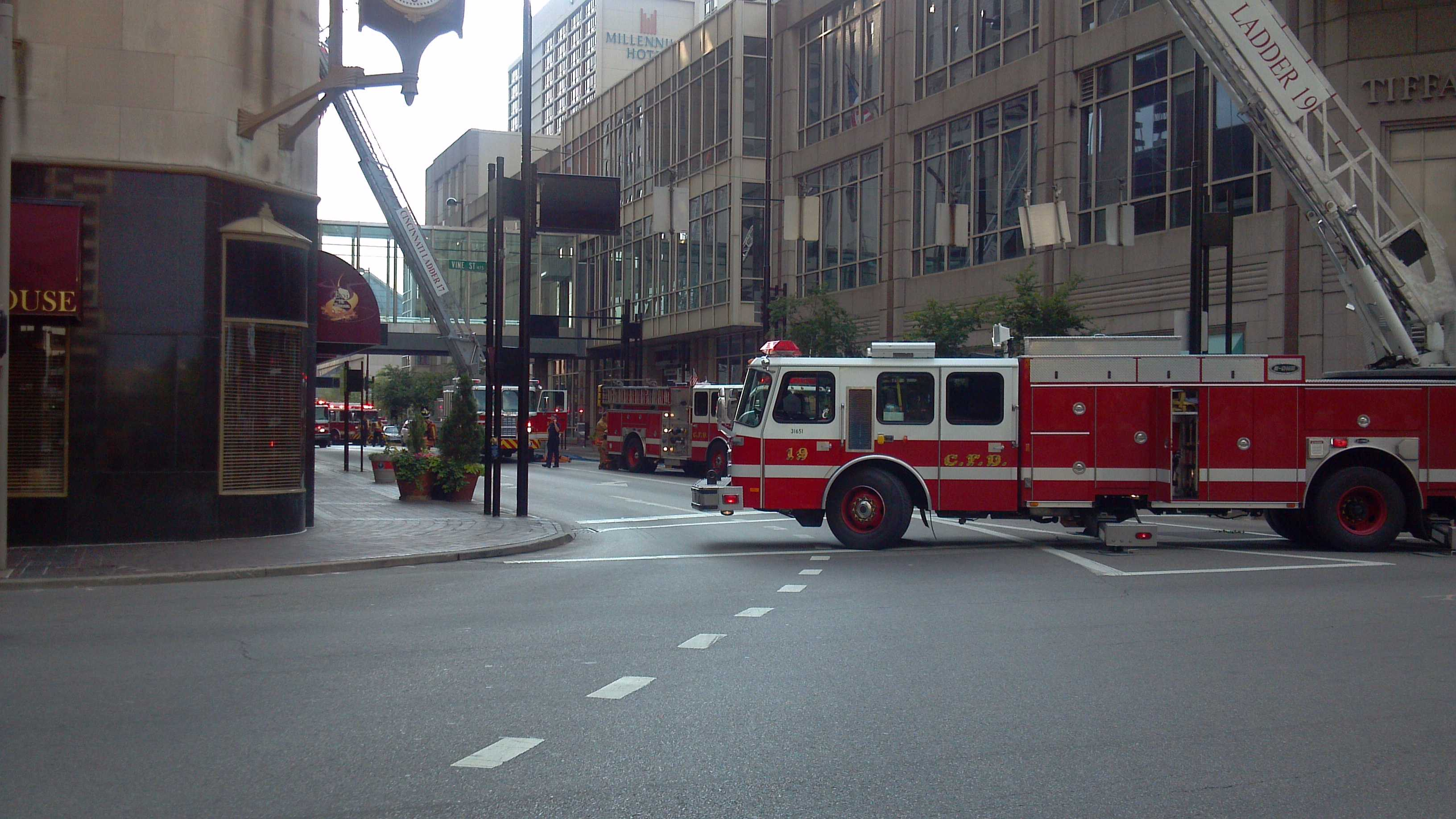 Fire crews evacuate Carew Tower after smoke is seen coming from the building.