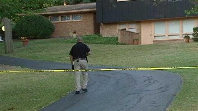 A woman in her 70s was injured when two men broke into her Amberley Village home.