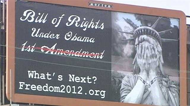 An area couple has bought advertisements on five billboards blasting the president for what they see as an attack on their religious freedom.