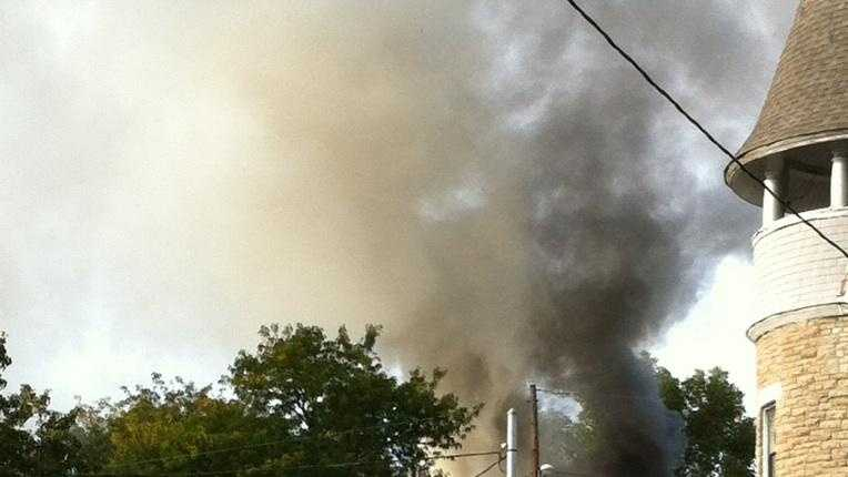 Fire crews battle a Hamilton Avenue house fire.
