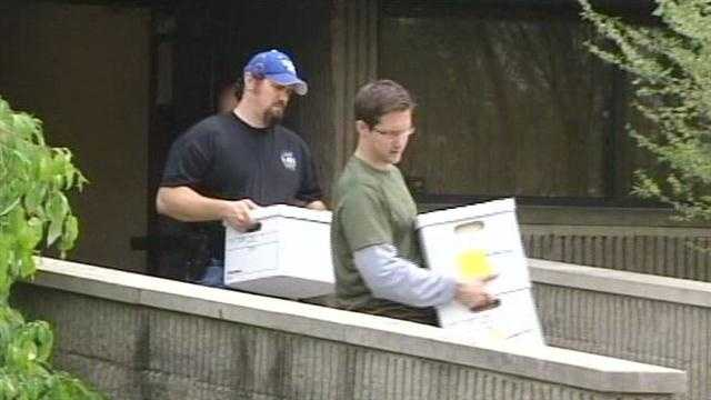 Federal agents remove documents from Dr. Gary Shearer's home in 2012.