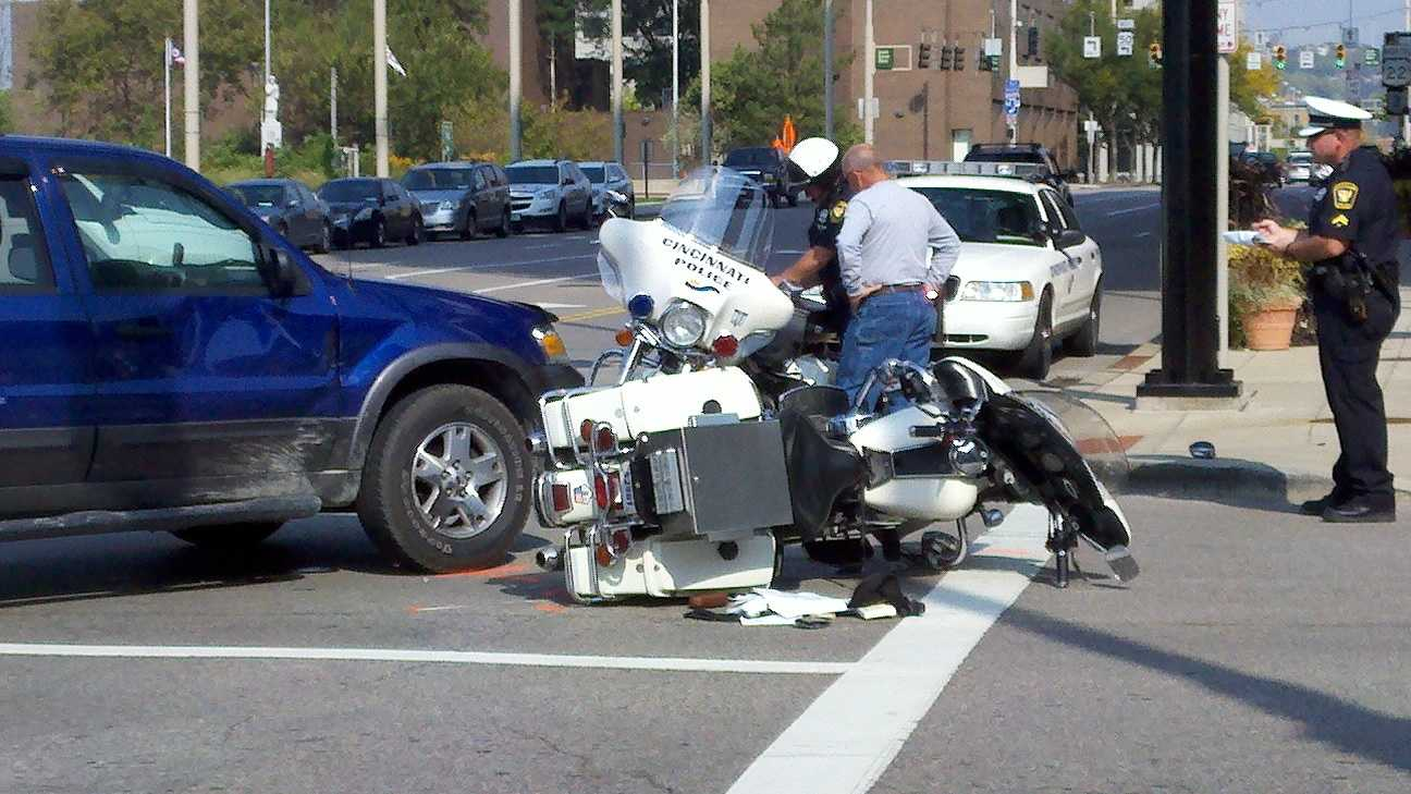 Motorcycle officer hurt in crash