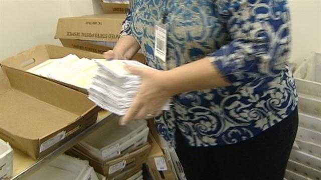 A poll worker in Hamilton County sorts ballots.