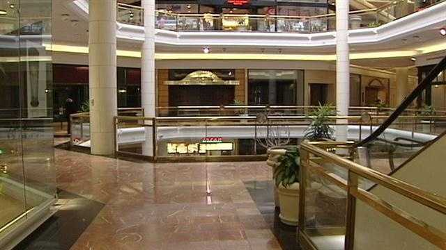 Two decades ago, Tower Place Mall was bustling with shoppers, but now it's practically empty.
