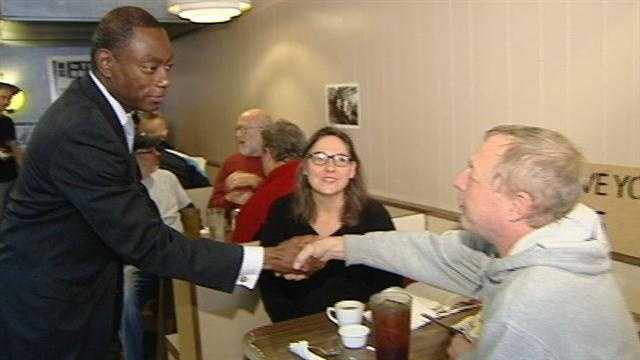 Mayor Mark Mallory meets guests at a downtown restaurant Saturday.