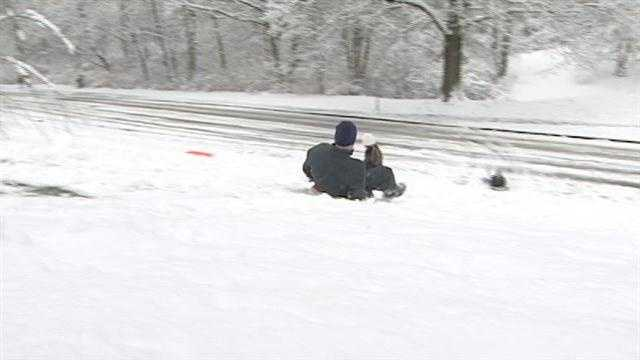 Parents and their kids got a chance to get outside Saturday and enjoy new snowfall.