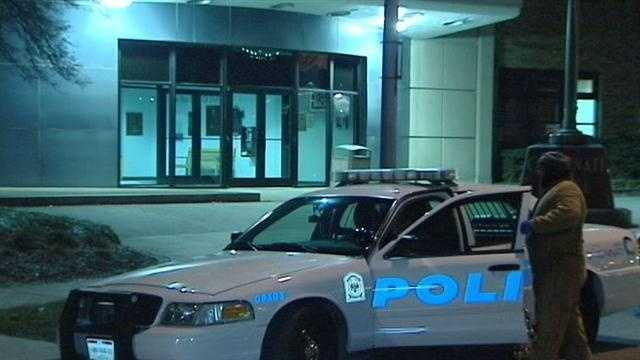 Police say two men were arrested in a stolen car overnight before getting out of jail and robbing a woman blocks away.